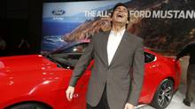 Ford Motor Co. chief operating officer Mark Fields laughes during an unveiling of its all new 2015 Ford Mustang in Dearborn, Michigan December 5, 2013. (REBECCA COOK/REUTERS)