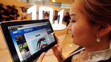 A South Korean model holds a Samsung Galaxy Tab 10.1 during its launch at the company's main building in Seoul in July. (PARK JI-HWAN/PARK JI-HWAN/AFP/GETTY IMAGES)