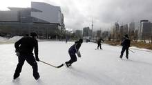 Fed Ex employees David Wishart, Mike Dalessio, Rex Duncan and Chris Fabre play a pick up hockey game on a break from work at the Sherbourne Commons rink at Sherbourne and Lakeshore in Toronto on January 15, 2014. (Deborah Baic/The Globe and Mail)