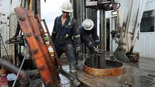 Oil-sands workers operate a rig near Fort McMurray, Alta., in September of 2010. (Kevin Van Paassen/The Globe and Mail)