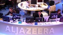 Al Jazeera English Channel staff prepare for the broadcast in Doha news room in Qatar. (Hamid Jalaudin/AP/Hamid Jalaudin/AP)