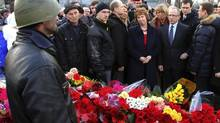 European Union foreign policy chief Catherine Ashton, middle, visits a memorial for victims of last week's clashes in Kiev February 24, 2014. Ashton arrived in Kiev to discuss measures to shore up the ailing economy, which the finance ministry said needs urgent financial assistance to avoid default. (Viktor Gurniak/REUTERS)