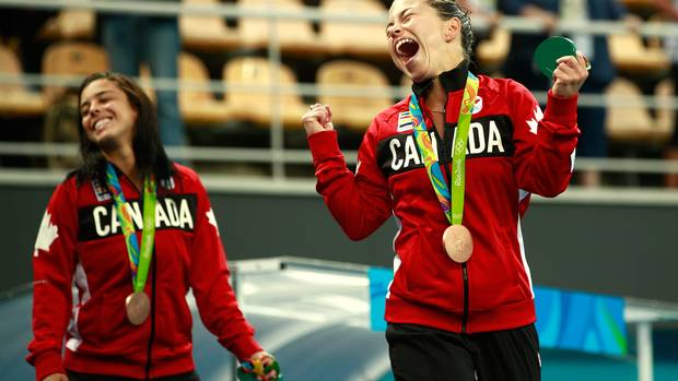 Roseline Filion (CAN) and Meaghan Benfeito (CAN) of Canada celebrate with their bronze medals.