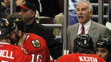 Chicago Blackhawks head coach Joel Quenneville talks to his players during the third period of Game 5 of an NHL hockey Western Conference second-round playoff series against the Vancouver Canucks Sunday, May 9, 2010, in Chicago. The Canucks won 4-1 (Nam Y. Huh/AP)