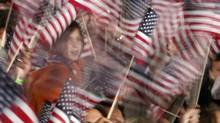 People wave U.S. flag (JIM YOUNG)