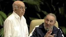 Cuba's Vice President Jose Ramon Machado Ventura, left, is applauded by Fidel Castro after being elected as secretary of Cuba's Communist Party in Havana, April 19, 2011. (Javier Galeano/AP/Javier Galeano/AP)