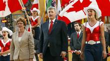 Prime Minister Stephen Harper sings the national anthem at the opening ceremonies for the World Skills Competition in Calgary, Sept. 1, 2009. (TODD KOROL)