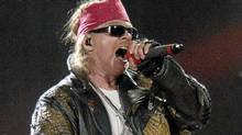 In an Aug. 14, 2010 file photo Guns N' Roses lead singer Axl Rose performs at the Rock and Rev Festival in Sturgis, S.D., during the 70th Annual Sturgis Motorcycle Rally. Axl Rose announced Wednesday April 11, 2012 that he won't be showing up to see Guns N' Roses inducted into the Rock and Roll Hall of Fame and declined the honor for himself. (Steve McEnroe/AP)