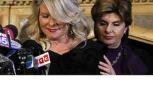 Lawyer Gloria Allred holds her client, Sharon Bialek, who has made new allegations of sexual impropriety against Republican presidential hopeful Herman Cain. (Brendan McDermid/Reuters)