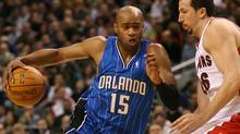 Orlando Magic's Vince Carter, left, drives to the basket past Toronto Raptors' Hedo Turkoglu during first half NBA action in Toronto November 22, 2009. (Darren Calabrese)