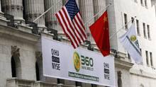 A sign advertising the Qihoo 360 Technology Co Ltd with the U.S. and Chinese flags outside of the New York Stock Exchange before the company's Initial Public Offering (IPO) in New York March 30, 2011. (LUCAS JACKSON/REUTERS)