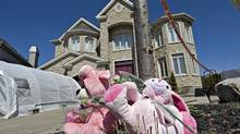 Plush toys form a makeshift memorial in front of a Laval, Que., home on Thursday April 2, 2009. Adele Sorella was convicted of first-degree murder in the deaths of her young daughters, Sabrina, 8, and Amanda, 9. (Patrick Sanfaçon/The Canadian Press)