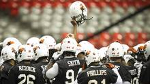 The B.C. Lions huddle-up for a cheer during practice at B.C. Place in Vancouver November 23, 2011. (John Lehmann/The Globe and Mail/John Lehmann/The Globe and Mail)