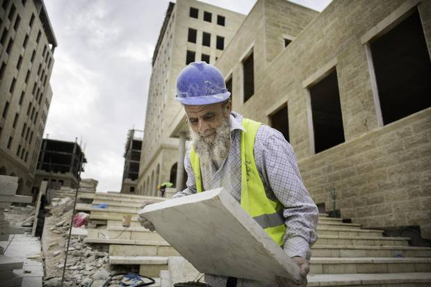 A Palestinian construction worker in Rawabi.