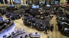 Traders work on the floor of the New York Stock Exchange in this file photo. (AP)