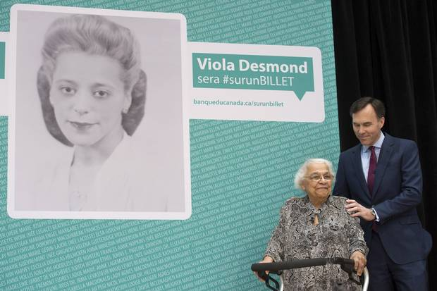 Finance Minister Bill Morneau puts his hand on the shoulder of Wanda Robson, the sister of Viola Desmond, at a ceremony in Gatineau, Que., on Dec. 8, 2016, where it was announced Ms. Desmond will be featured on the new $10 bill.