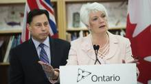 Ontario Minister of Education Liz Sandals (left) and Minister of Training, Colleges and Universities Brad Duguid (right) during an announcement that the government will be doubling the time students spend in teacher's college and reducing teacher's college admissions in the province by 50 per cent. Ms. Sandals announced Friday that nine complaints about unlicensed daycares went unanswered last year. (Della Rollins For The Globe and Mail)