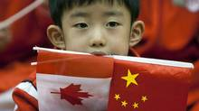 A student keeps his eyes wide during a visit by Prime Minister Stephen Harper to the Canadian International School in Beijing on Dec. 4, 2009. (Sean Kilpatrick/The Canadian Press)
