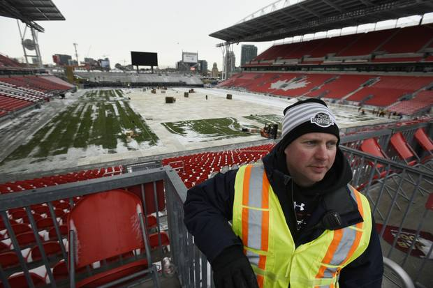 Mike Craig, NHL senior manager of facilities, looks at the work under way at BMO Field to prepare for the game.