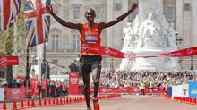 Kenya's Wilson Kipsang celebrates his win as he crosses the finish line during the London Marathon on Sunday. (Sang Tan)