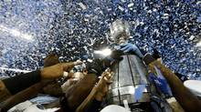 The Grey Cup is hoisted by the Toronto Argonauts (MARK BLINCH/REUTERS)