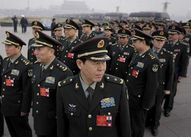 Delegates from China's People's Liberation Army arrive at the Great Hall of the People to attend a session of National People's Congress in Beijing on March 4, 2016.