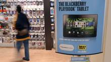 A sign advertising a Research In Motion's PlayBook tablet is seen in FairOaks Mall,Virginia April 19, 2011. (© Larry Downing / Reuters/REUTERS)
