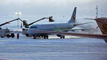 An Air Canada aircraft is de-iced on the tarmac at the airport in Halifax on Wednesday, Feb. 9, 2011. (Andrew Vaughan/The Canadian Press/Andrew Vaughan/The Canadian Press)