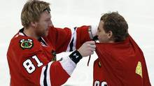 Chicago Blackhawks Marian Hossa (L) ties a Superman cape on teammate Patrick Kane during the NHL All-Star hockey skills competition in Ottawa January 28, 2012. REUTERS/Blair Gable (Blair Gable/Reuters)