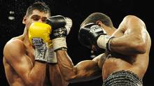 Amir Khan, left, of England, battles, Lamont Peterson, right, during a boxing match, Saturday, Dec. 10, 2011, in Washington. Khan was defeated in a split decision. (AP Photo/Nick Wass) (Nick Wass)