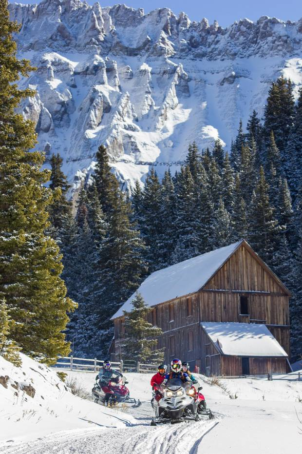 Weather permitting, Telluride Outside offers snowmobile day trips up to the ghost town of Alta.