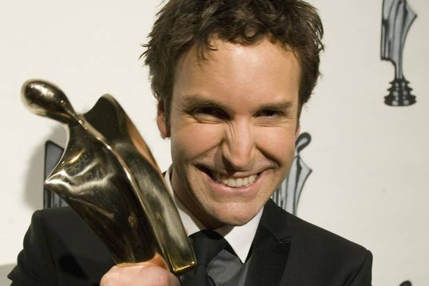 Éric Salvail holds up his trophy for best variety show host at the Artis television gala in Montreal on April 29, 2007.