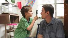 Ethan Hawke (right) in a scene from Boyhood, a Richard Linklater drama shot over 12 years. (THE CANADIAN PRESS)