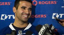 Toronto Maple Leafs forward Nazem Kadri laughs as he speaks to the media during NHL opening day training camp in Toronto on Wednesday, Sept. 11, 2013. (Nathan Denette/THE CANADIAN PRESS)