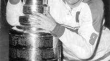 Rocket Richard hugs the Stanley Cup in 1960. (Harry McLorinan/The Globe and Mail)