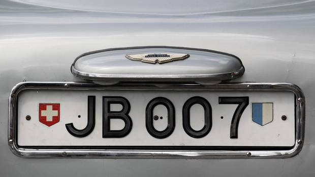 "The rotating number plate on the original Aston Martin DB5, driven by actor Sean Connery in the James Bond films ""Goldfinger"" and ""Thunderball"" is displayed in London in 2010. The car fetched £2,600,000, less than the estimated £3,000,000 ($4,700,000). (SUZANNE PLUNKETT/REUTERS)"