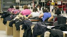 Workers piece together outerwear on the manufacturing floor of Canada Goose's facility in Toronto Jan. 17, 2012. Despite significant challenges, Canadian manufacturers have managed to make some impressive gains over the past decade. (FRED THORNHILL/REUTERS/FRED THORNHILL/REUTERS)