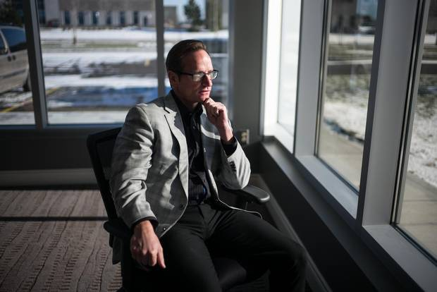 Andrew Sharpe, president of IO Industries, sits at the company's new headquarters in London, Ont.