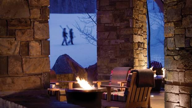 Fireside pits sit slopeside at Four Seasons Jackson Hole Mountain Resort.
