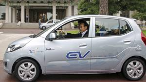 South Korean President Lee Myung-bak test dirves Hyundai's electric vehicle, BlueOn, in the compound of the presidential house in Seoul, South Korea, Thursday, Sept. 9, 2010.