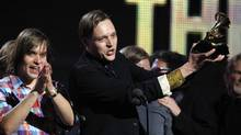"Edwin Butler of Canadian band Arcade Fire holds up the Grammy for Album of the Year for ""The Suburbs"" at the 53rd annual Grammy Awards in Los Angeles, California February 13, 2011. (Lucy Nicholson / Reuters/Lucy Nicholson / Reuters)"