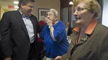 Former MP Denis Coderre, campaigning at a seniors home, is seen as the favourite in Montreal's municipal election. (Graham Hughes/The Canadian Press)