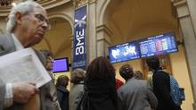Visitors look at computer screens at Madrid's bourse as shares in Europe's biggest companies fell April 10. Fidelity Worldwide is struggling to stay ahead of the pack of money managers invested in Europe. (ANDREA COMAS/REUTERS)