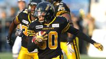 Hamilton Tiger-Cats' Chris Williams (C) carries the ball 117 yards on the return of a missed field goal by the Montreal Alouettes in the first half of their CFL game in Hamilton July 21, 2012. (FRED THORNHILL/REUTERS)