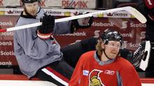 Ottawa centre Jason Spezza, left, says he was as shocked as anyone by his long-time teammate and captain Daniel Alfredsson's departure to the Red Wings. (FRED CHARTRAND/THE CANADIAN PRESS)