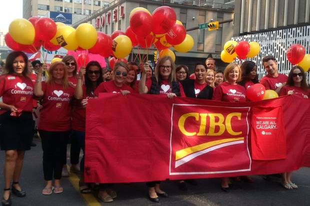 Canadian Imperial Bank of Commerce employees are involved in a variety of community initiatives, such as fundraising for cancer research and children's charities. Here, they march in the Calgary Stampede parade.