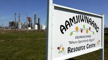 A sign for the Aamjiwnaang First Nation Resource Centre is located across the road from NOVA Chemicals in Sarnia, Ont., on April 21, 2007. A new study has shed light on the health problems facing a First Nations community living near one of Canada's most industrialized areas. (Craig Glover/THE CANADIAN PRESS)