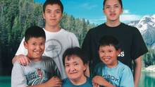 Edward (Eddie) Snowshoe, back row, right, poses for a photo with his mother and three brothers.