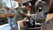 An eviction team removes belongings from an foreclosed home in Aurora, Colo. (John Moore/2010 Getty Images)