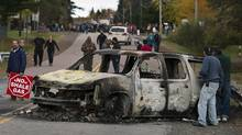 A police vehicle is seen in Rexton, N.B., on Oct. 17, 2013. In the end, at least 40 people, including Elsipogtog Chief Arren Sock and several council members, had been arrested and five police cruisers had been set ablaze. (ANDREW VAUGHAN/THE CANADIAN PRESS)